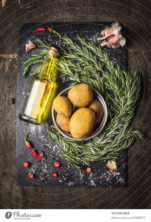 Potatoes with rosemary, spices and a bottle of oil. Food Vegetable Herbs and spices Cooking oil Nutrition Lunch Organic produce Vegetarian diet Diet Beverage