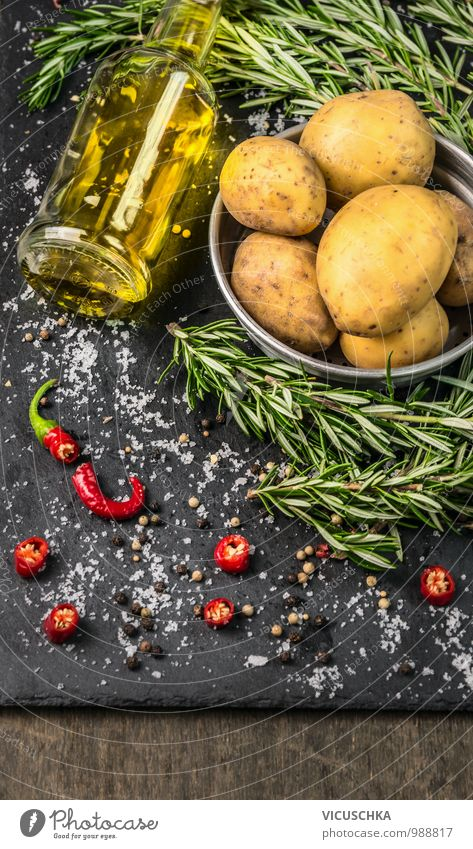 Rosemary prepare potatoes with spices and a bottle of oil Food Vegetable Herbs and spices Cooking oil Nutrition Lunch Dinner Organic produce Vegetarian diet