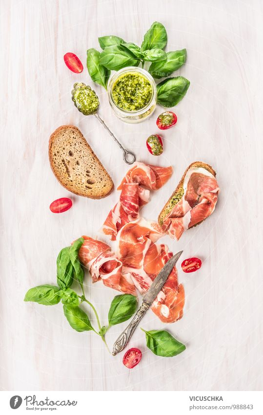 Parma ham with toast , basil pesto and tomatoes Food Meat Sausage Vegetable Lettuce Salad Bread Herbs and spices Cooking oil Nutrition Lunch Buffet Brunch