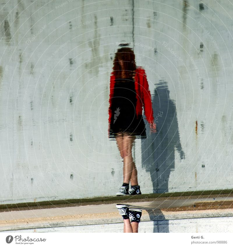 faceless Reflection Surface of water Distorted Woman Mini dress Black Little black dress Jacket Red Slowly Wall (barrier) Wall (building) Sky blue Green Gray