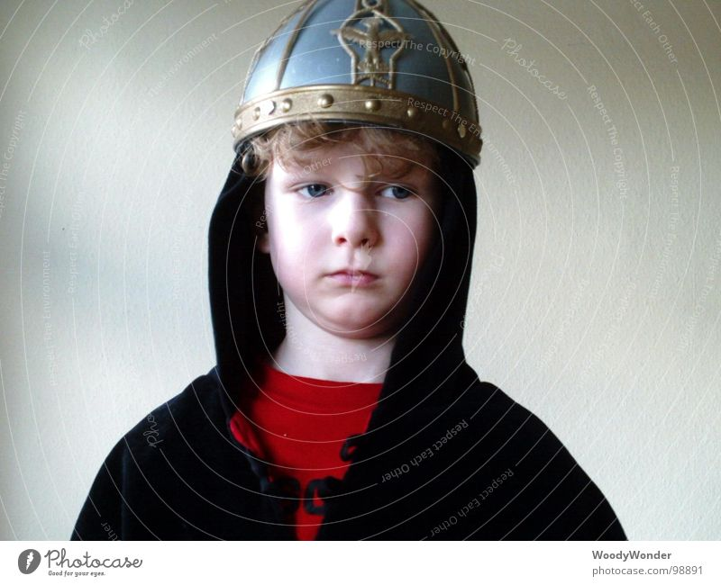 Child Boy (child) Dream Sadness Think Grief Mask Carnival Longing Profession Hero Fairy tale Helmet Lacking Dress up Knight