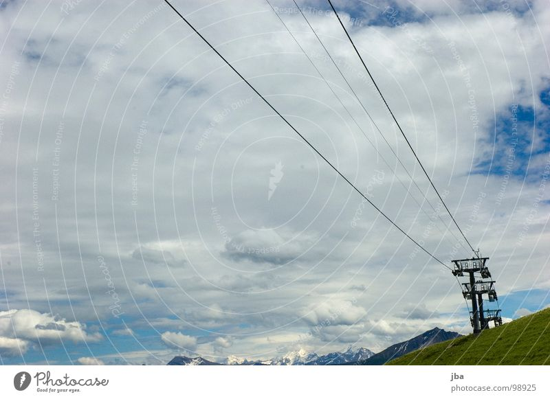 summer break Chair lift Wire 3 Slope Grass Clouds Bad weather Rope Mountain Tall Above Upward Electricity pylon Sky