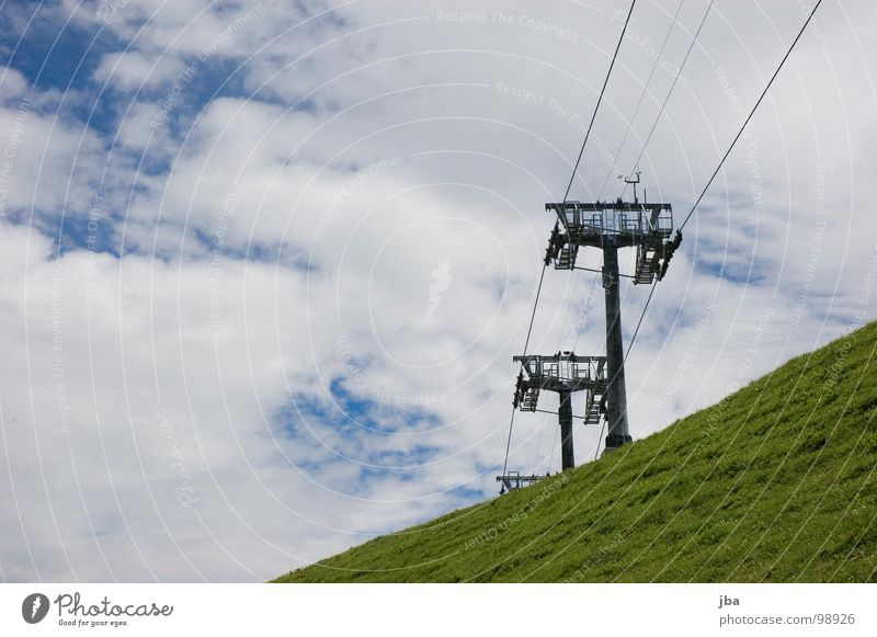 Summer break II Chair lift Wire 3 Slope Grass Clouds Bad weather Rope Mountain Tall Above Upward Electricity pylon Sky