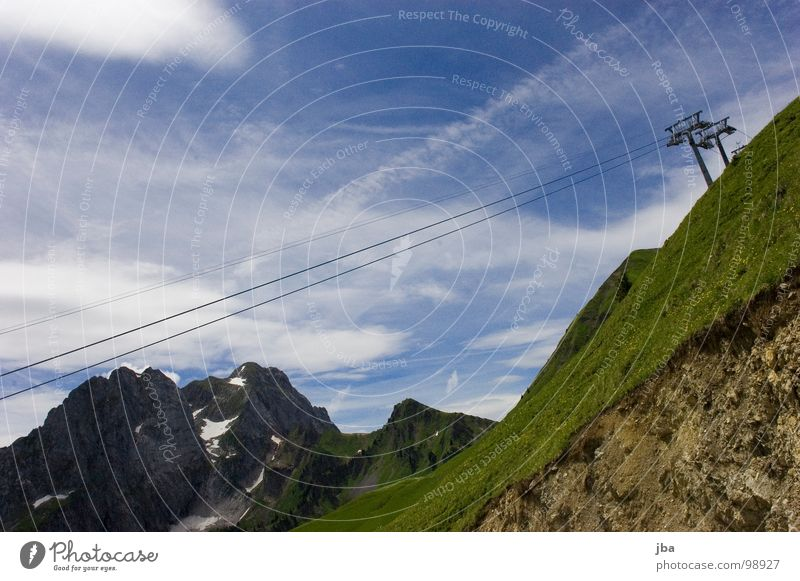 Sky Clouds Mountain Above Grass Rock Tall 3 Rope Electricity pylon Upward Wire Slope Steep Dismantling Bad weather
