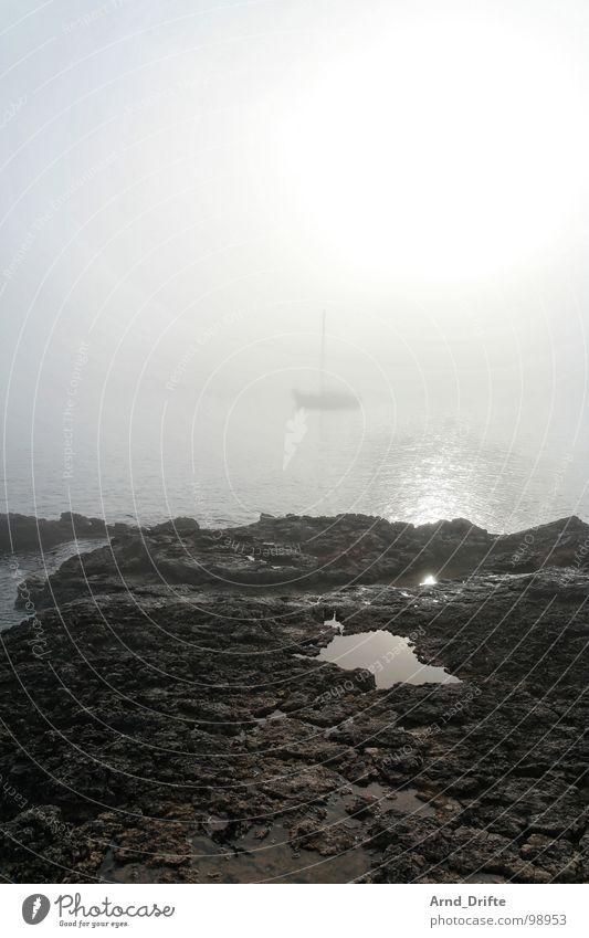 Water Sky Ocean Beach Stone Watercraft Coast Fog Rope Rock Puddle Sailboat Morning fog