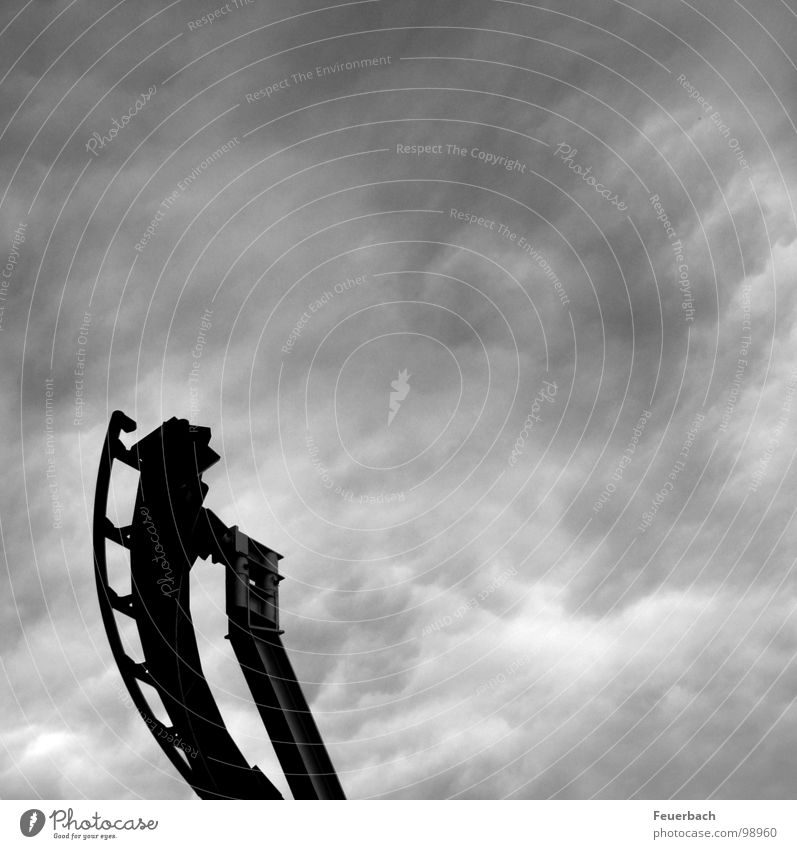 Roller coaster into nowhere Black & white photo Exterior shot Structures and shapes Deserted Contrast Freedom Fairs & Carnivals Sky Clouds Storm clouds Weather