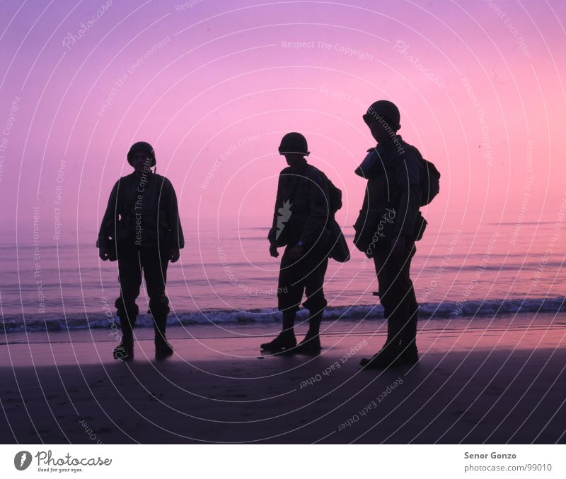 D-Day Landing Adventure Sun Beach Ocean Waves Human being Masculine Man Adults 3 Water Sky Horizon Sunrise Sunset Coast Boots Helmet Bizarre Normandie