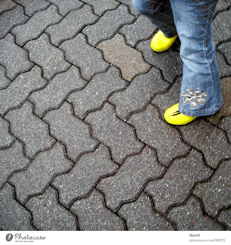 Child Yellow Playing Movement Leisure and hobbies Asphalt Boots Toddler Cobblestones Paving stone Seam Rubber boots Highway ramp (entrance) Zigzag Children's game Wavy line