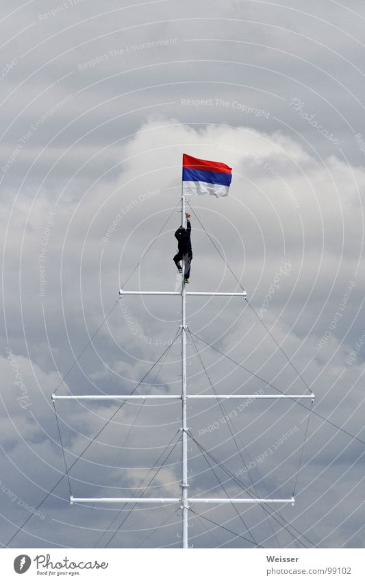 Russian sailor Man Flag Sailing Watercraft Dramatic Clouds Bad weather Flagpole Success Sky Seaman Climbing