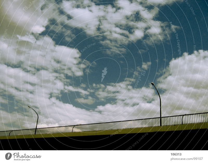 Sky Old Clouds Street Architecture Lanes & trails Wall (barrier) Lamp Line Bright Metal Energy industry Technology Electricity Bridge Cable