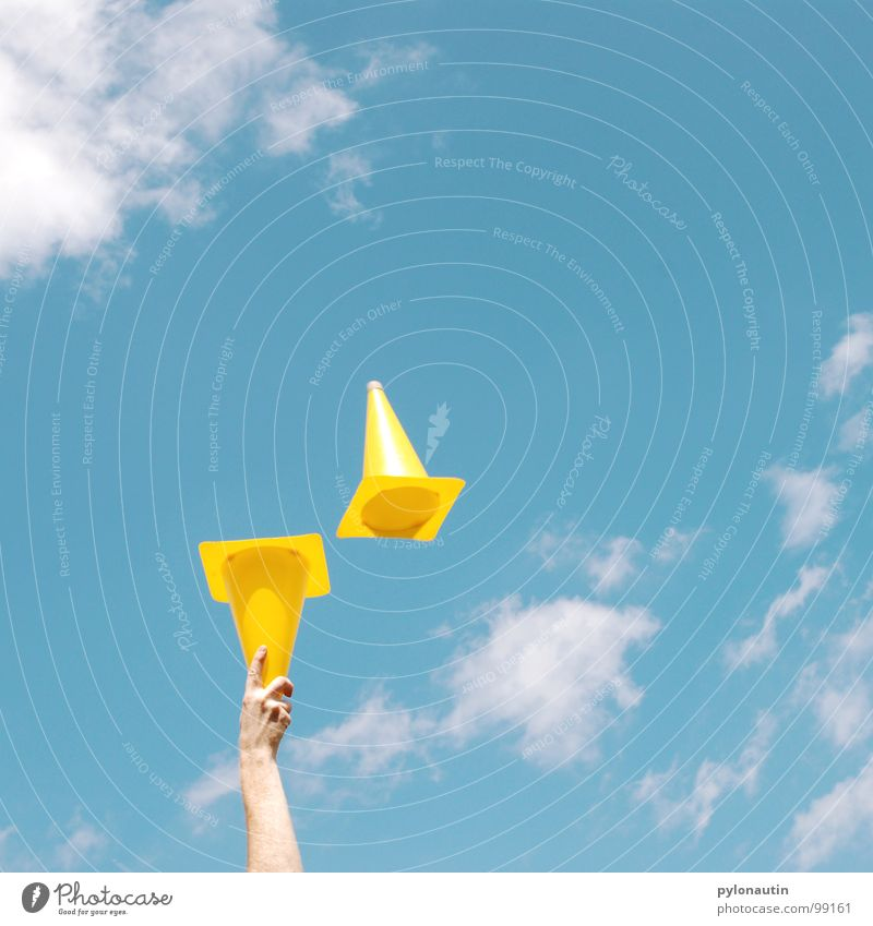 Pylons in the sky Yellow Clouds Hand Juggle Playing Traffic cone Sky Blue Arm Flying Plastic