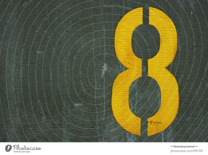 >>8<< Yellow Wall (building) Digits and numbers Parking lot Gray Black Lime Geometry Traffic infrastructure Arrangement