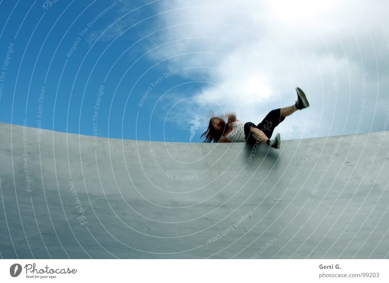 imbalance Brave To fall Woman Young woman Long-haired Footwear Chucks Articulated Dislocate Edge Edge of a plate Ramp Surface Wall (building) Sky blue Heavenly