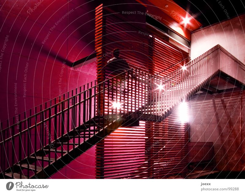 Transparent ascent Go up Dark Ghostly Green Career Long exposure Light Man Wall (barrier) Night Night shot Upper body Red Informer Wall (building) Modern Stairs