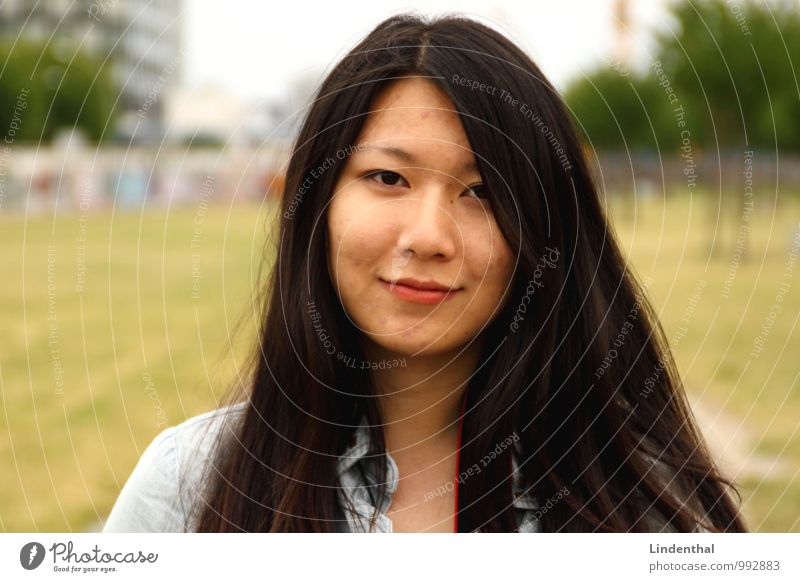 Berlin Portrait F#1 Hair and hairstyles Face Woman Adults Lips Meadow Black-haired Green Red Asians Downtown Berlin Smiling Laughter Colour photo Exterior shot