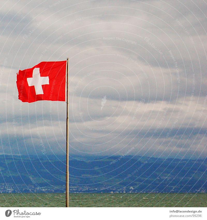 View of Switzerland Flag Clouds Friedrichshafen Judder Swiss Red Green Colour Europe Lake Constance Coast Wind flagpole Electricity pylon Back schwiz Blue