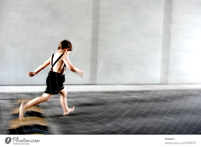 Child Playing Boy (child) Jump Costume Healthy Going Walking Concrete Beginning Running Traffic infrastructure Barefoot Haste Hop Leather shorts