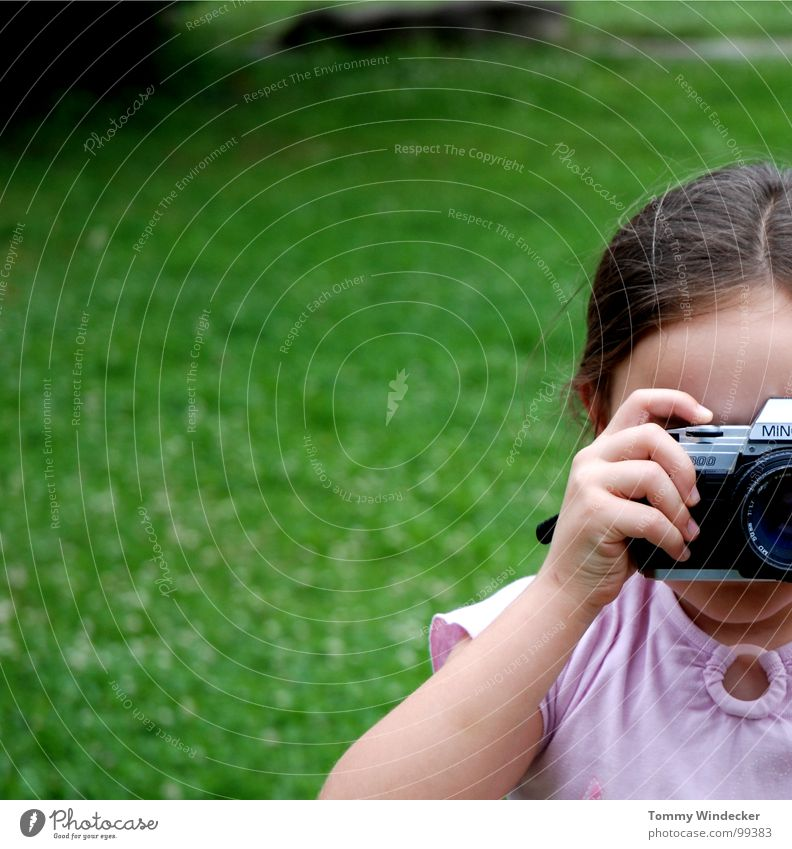 Photogen(s) Girl Child Talented Photography Take a photo Snapshot Hand Fingers Meadow Camera Braids To hold on Filming Analog Posture Education Minolta