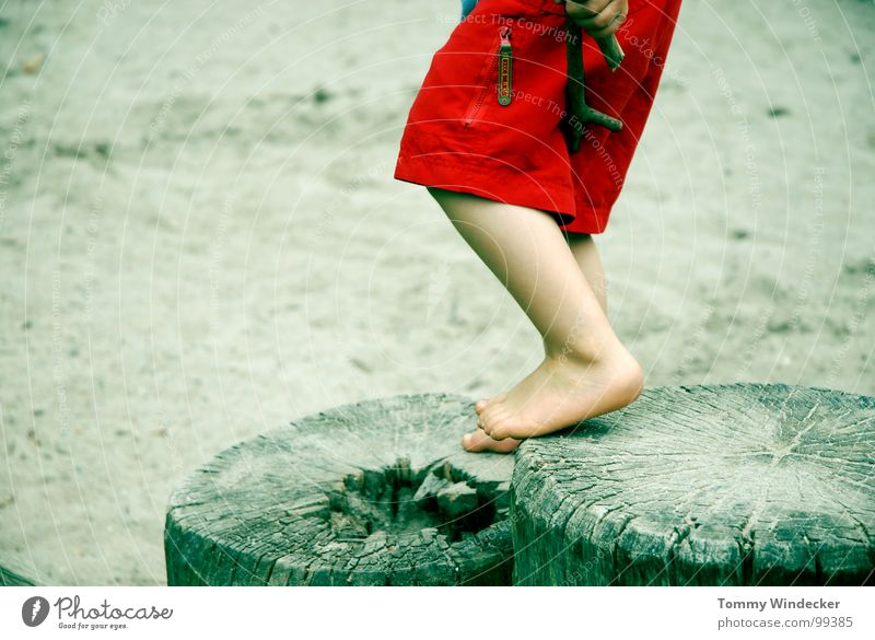 With both legs II Playing Vacation & Travel Leisure and hobbies Child Sandpit Playground Ocean Beach Barefoot Children's foot Children's leg Stand Legs apart