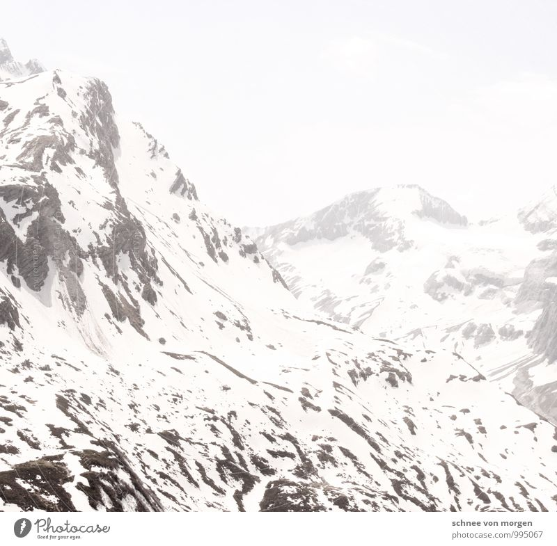 mountain air Environment Nature Elements Air Climate Lightning Ice Frost Snow Snowfall Hill Rock Alps Mountain Peak Snowcapped peak Glacier Black White Calm