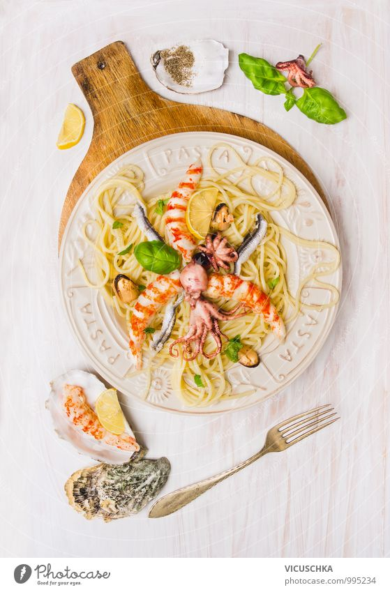 Spaghetti seafood with anchovies, shrimps and octopus Food Seafood Herbs and spices Cooking oil Lunch Banquet Crockery Plate Fork Style Design Healthy Eating
