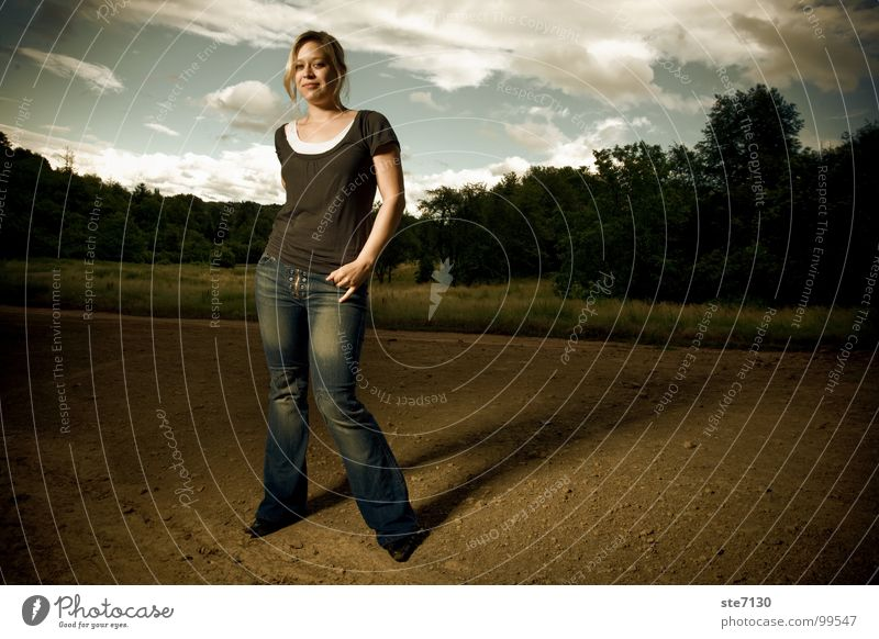 Danielle with clouds in the background Blonde Clouds Rural Dramatic Green Meadow Dark Woman Americas Jeans Sky flash