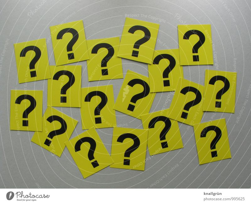 Questions over questions Sign Signs and labeling Communicate Sharp-edged Curiosity Yellow Gray Black Emotions Mysterious Surprise Question mark Ask Colour photo