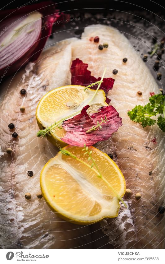 Lemon half on raw zander fish fillet Food Fish Fruit Herbs and spices Cooking oil Nutrition Lunch Dinner Organic produce Vegetarian diet Diet Style Design