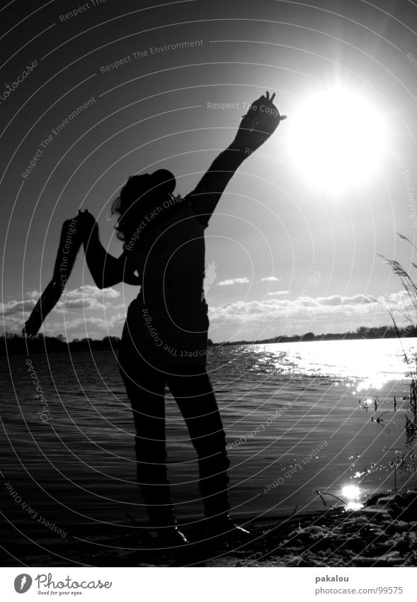 catch a part of the sky Catch Dark Back-light Woman Human being Lake Horizon Longing Scarf Reflection Black & white photo Autumn Shadow silouette Nature Water