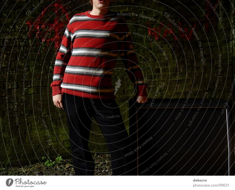 Boy standing next to a guitar amp in a derelict railway tunnel. Striped Cave Tunnel Red Black Dark Loudspeaker Intensifier Sweater Fellow Youth (Young adults)