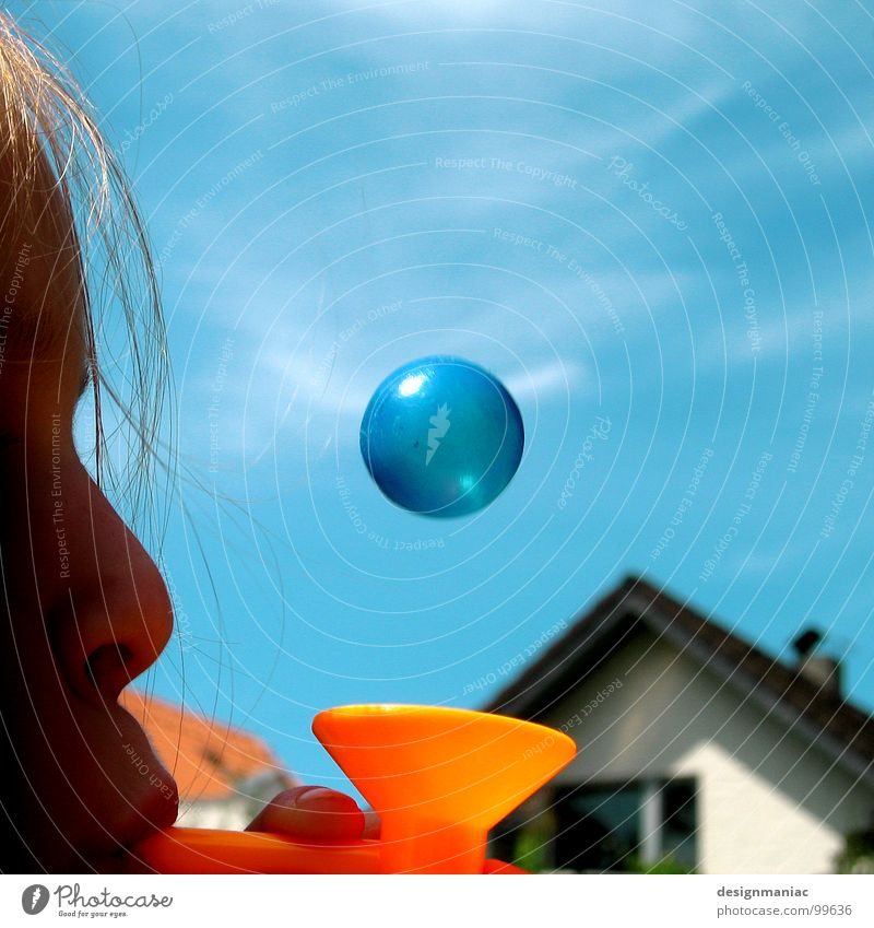 What's round, small and blue? Child Girl House (Residential Structure) Clouds Round Middle Blow Blonde Planet Window Roof Magic Weightlessness Funnel Playing