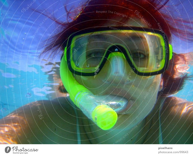 WHAT ARE YOU LOOKING AT????? Yellow Snorkeling Red-haired Mouthpiece Indian Ocean Air Breathe Woman Surface Reflection Light Aquatics Water Blue Transparent