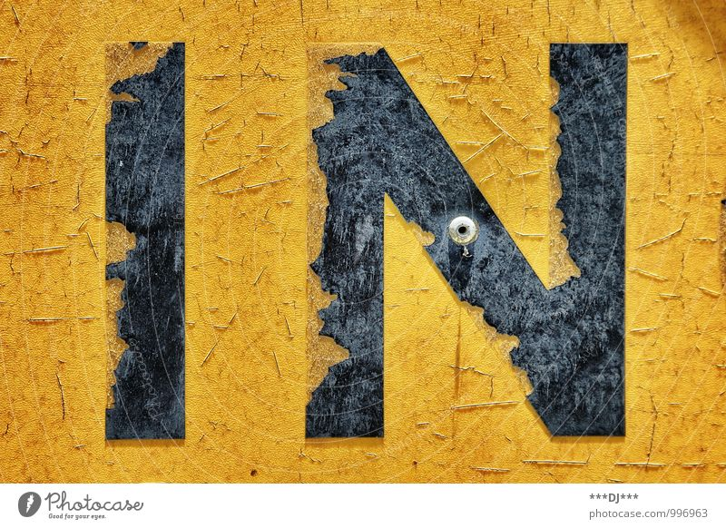IN yellow and black | IN yellow and black Lifestyle Style Design Industry Art Work of art Media Stone Wood Metal Steel Rust Plastic Sign Characters