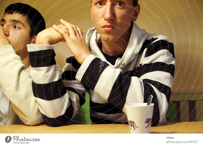 scrutinizing Looking Friendship Youth (Young adults) Eyes Hand Fingers Power Honest Hesitate Light and shadow Facial expression Support Force Open Table edge