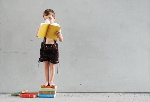Child Hand Yellow Costume Wall (building) Boy (child) Germany Infancy Book Tall Concrete Study Academic studies Growth Stand Reading