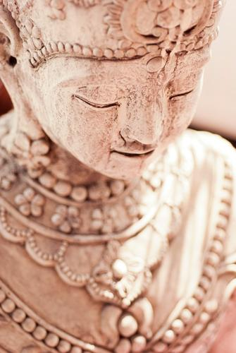 Beautiful Feminine Happy Brown Contentment Decoration Smiling Friendliness Asia Serene Heavenly Statue Smooth Sculpture Work of art Buddhism