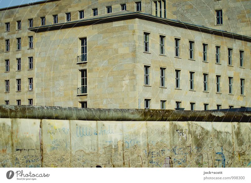 Walls of terror Sightseeing Urban development Downtown Berlin Office building Facade Tourist Attraction The Wall Stone Concrete Section of image