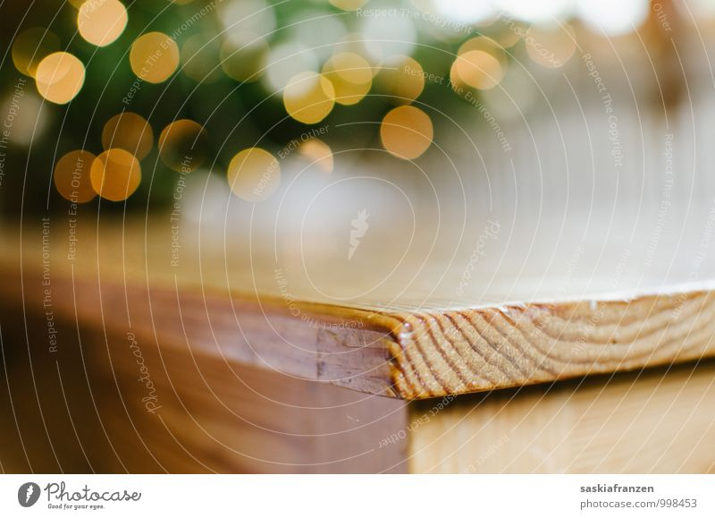 On the edge. Wood Esthetic Sharp-edged Simple Glittering Near Warmth Soft Table Tabletop Table edge Wooden table Fairy lights Colour photo Interior shot