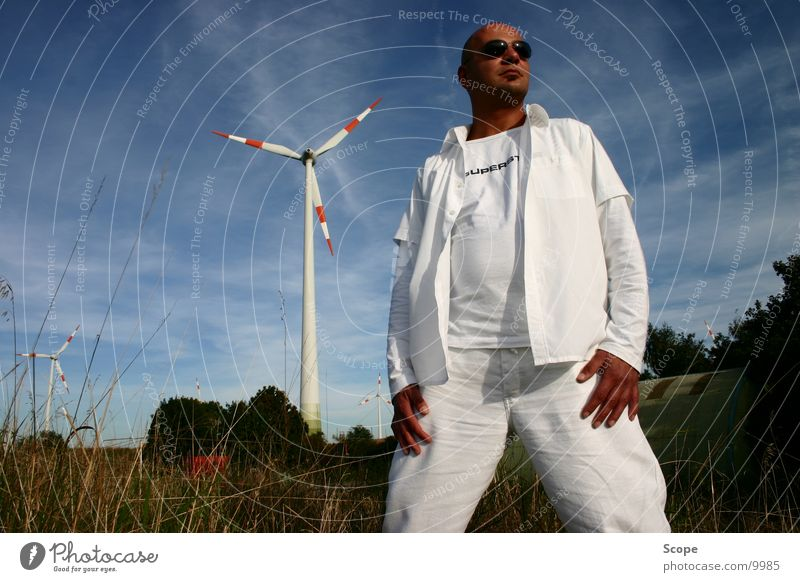 Sky Man White Wind energy plant Disc jockey Blue sky Dugout