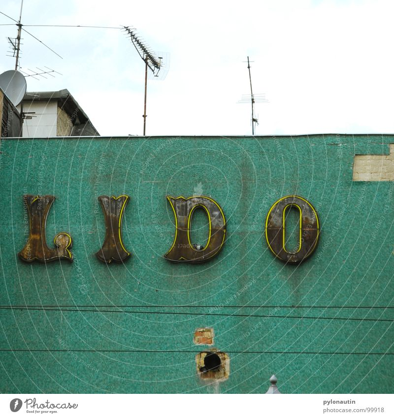 Lido Turquoise Neon sign House (Residential Structure) Typography Roof Antenna Wall (building) Derelict Cable Sky