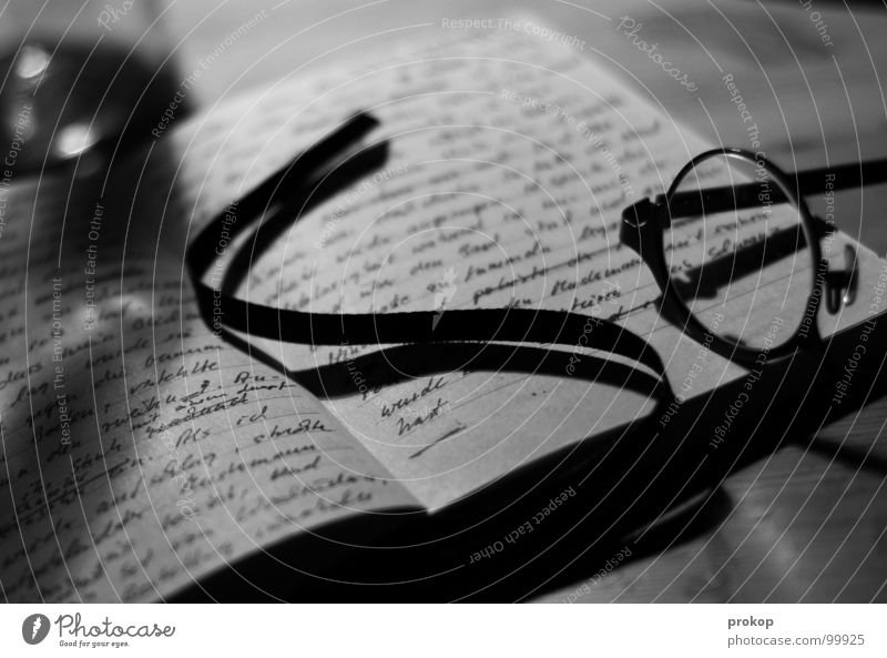 Notebook - II Piece of paper Eyeglasses Reading Letters (alphabet) Handwriting Poetic Closed Poem Word Diary Struck Table Depth of field Illegible Art Culture