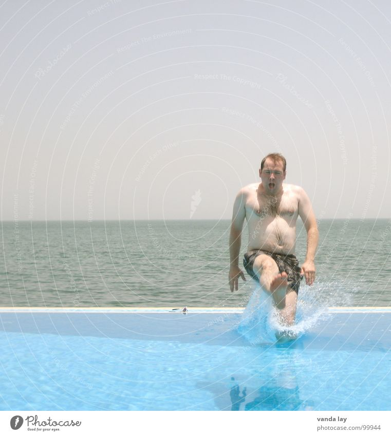 Man Blue Water Vacation & Travel Summer Ocean Beach Joy Playing Coast Jump Horizon Brown Swimming & Bathing Wet Swimming pool