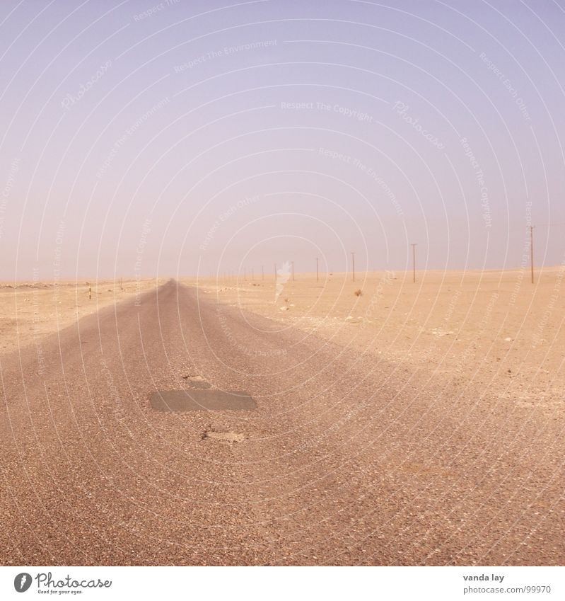 Highway to Hell Iraq War Loneliness Empty Horizon Basra Asphalt Pothole Electricity pylon Right ahead Vanishing point Traffic infrastructure Desert Boredom